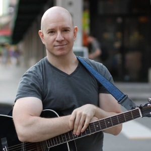 Josh Rachlis with guitar